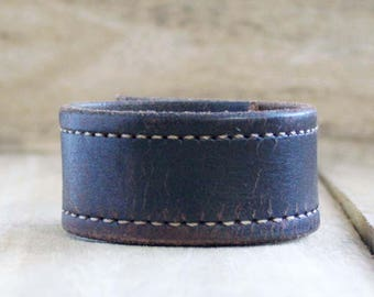 CUSTOM HANDSTAMPED distressed narrow black leather cuff with stitching by mothercuffer
