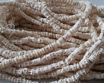 "Senegal very tiny fish bone beads (6/7 mm. diam.) strand 16"", 100/130 vertebrae, organic beads, Fair Trade"