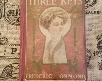 1909 copy of antique romance book The Three Keys by Fredric Ormond