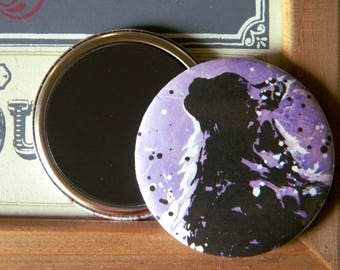 Magnet with a silhouette of CAT on purple background