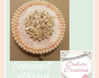 Compact mirror in Pink shades with diamanté centerpiece.