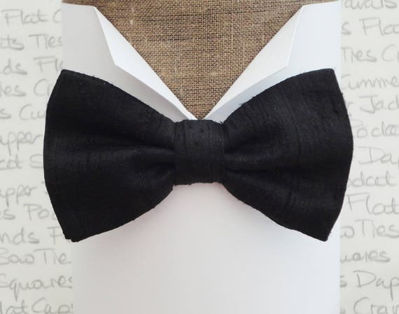 "Black silk bow tie, pre tied, or self tie, will fit neck size 14"" to 19"""