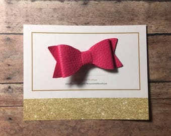 Pink leather bow clip