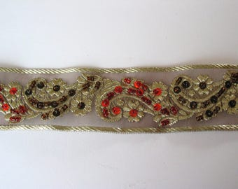 Organza lace embroidered in thread with beads and sequins