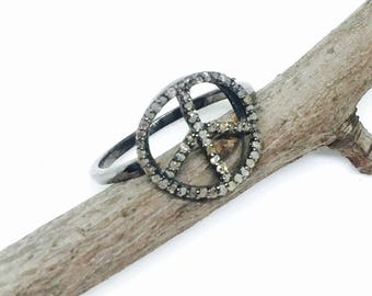 Pave diamond peace sign ring set in Sterling silver (92.5) Size -8.Genuine authentic diamonds. Satisfaction guaranteed