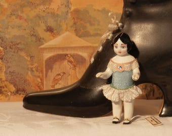 12th scale model of a dolls house toy doll