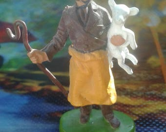 Vintage Man Holding Lamb/Britain Ltd.