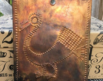 Bird design punched tin pattern in copper panel