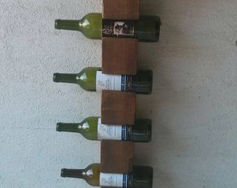 Wall wine rack for nine bottles.