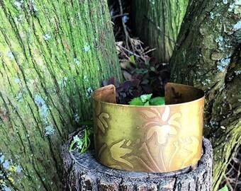 A handmade brass etched and oxidized flowers boho, gypsy cuff bracelet .