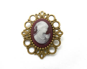 Bronze brooch and white cameo cabochon on a red background dark charms and co.