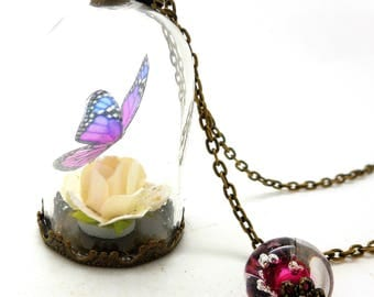 Necklace glass globe Butterfly pink and blue beads spun pink charms and co.