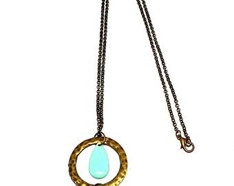 Necklace bronze, hammered round, dark grey tassel and green enamel charm of water