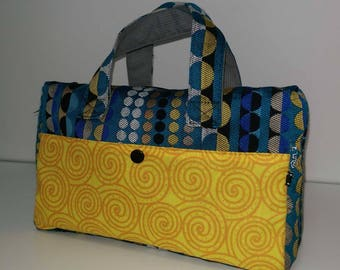 Toiletry bag in blue, white and yellow graphic fabric.
