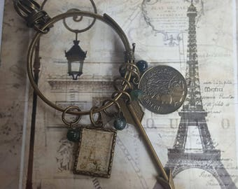 Paris Souvenir Brass Charms Necklace:Wrapped Metal and Ring, Custom Made Eiffel Tower Graphic, Arrow, French Coin Replica & Jade Color Beads
