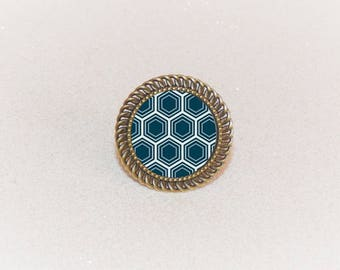 Ring silver adjustable cabochon blue/yellow geometric pinwheel pattern
