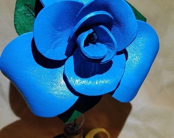 Handmade turquoise leather rose photo holder in a vintage door knob