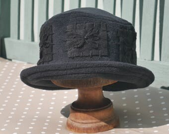 Black embroidered daisy flower fleece cloche fleece hat