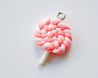 Pink and white polymer clay lollipop charm