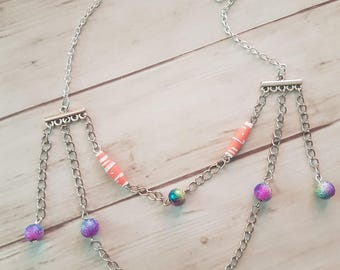 Necklace chains and paper beads and multicolored