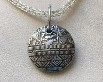 PMC sterling silver large lentil reversible bead on sterling silver viking knit chain.