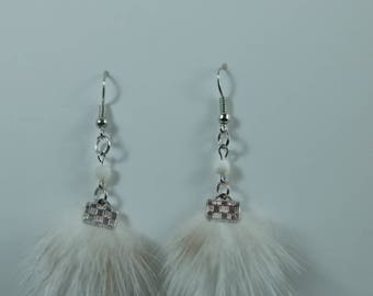 Earrings made with recycled fur