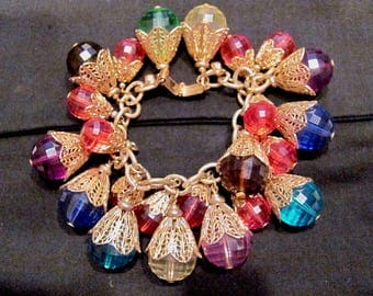 Vintage NAPIER Signed Chunky Faceted Jewel Tones Lucite Dangle Bracelet Cha Cha Charm Gold Filigree Caps Women's Fashion Costume Jewelry EUC