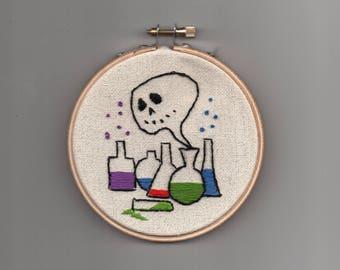 Alchemy ghost bottles, morbid mad scientist lab skull Halloween embroidery crewel hoop, needlepoint, gothic witchcraft occult horror art