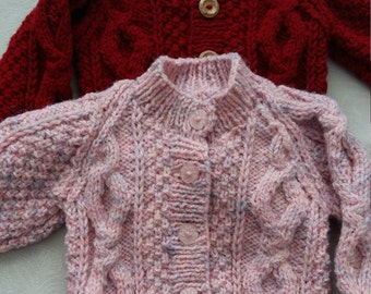 Hand knitted baby aran cardigan