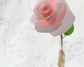 Large pink paper rose, with glass single stem vase.