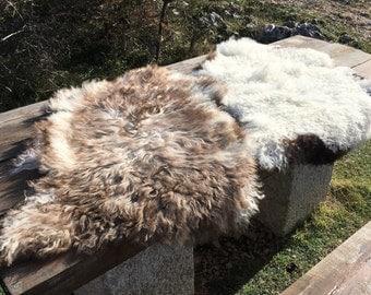 Two large genuine sheepskin rugs from Bosnia / 51 / 54