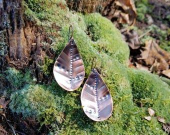 Handmade textured copper earrings.