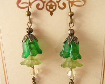 Gear earrings with green flowers