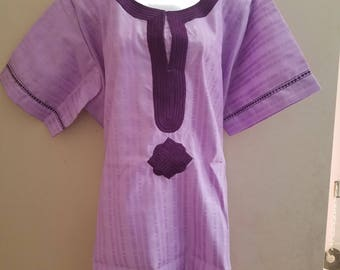 a purple colored large size embroidered top and pants