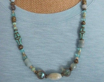 "Glass Goddess - Czech Glass Beads with Amazonite and Brass Buddha Heads and Accents 24"" No Clasp"