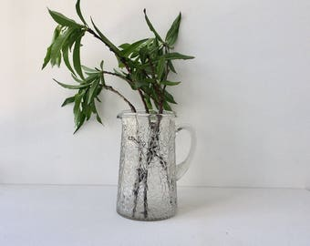 Glass drink pitcher with geometric design