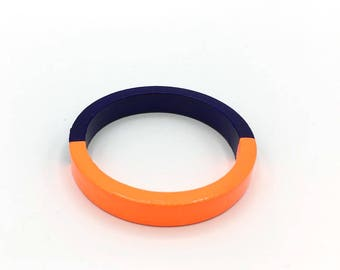 Handmade  bright  thin wooden bangle in neon orange and royal blue