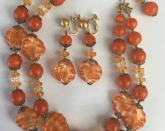 A Vintage necklace and earrings set by Hattie Carnegie in orange