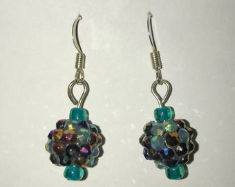 Black beads with multi colored rinestones. Teal beads at the top and the bottom.