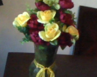 Listing 107 is a Floral Arrangement maroon and yellow in a tall glass vase