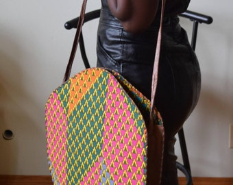Cloth covered leather hand bag.