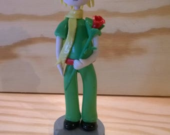 Decorative figurine: boy and his rose cold porcelain.