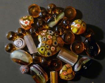 31 Indian amber yellow, various shapes millefiori glass beads