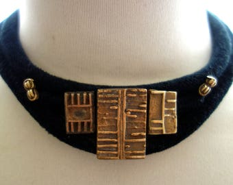 Ethnic jewelry with old gold weights from Ghana
