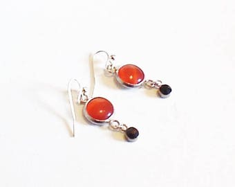 Boucle d'oreilles cabochons orange et strass noirs,