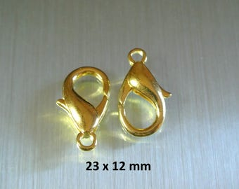 Set of 5 Golden hooks, 23 x 12 mm, hole size: 2.9 mm