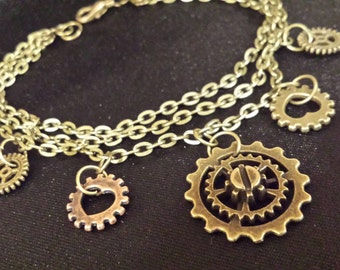 Hand Crafted Whimsy Triple Chain Steampunk Bracelet with Antique Bronze and Copper Tone Gears Cogs Trinket Triple Strand Bracelet