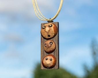 A thin neck and three hazelnuts