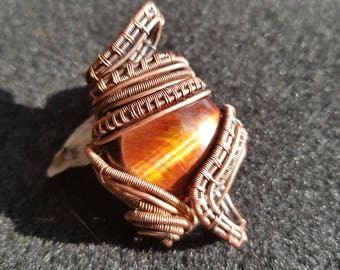 Red tiger's eye copper pendant