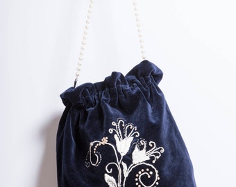 Velvet bag with handmade embroidery in ivory and pearls